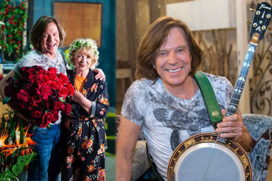 """Jürgen Drews, Schlagersänger, und Madeleine Lierck-Wien, Schauspielerin, stehen im Studio, in dem """"Rote Rosen"""" gedreht wird. Der Sänger ist in seinem Gastspiel unter anderem auf der Suche nach seinem Banjo."""