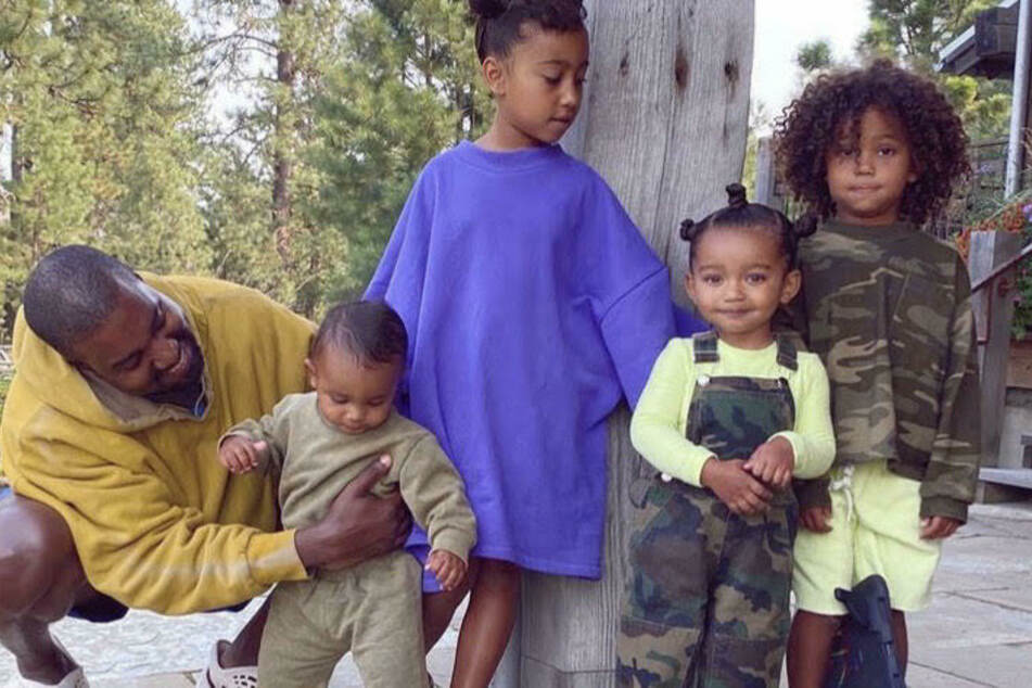 Kim shared a shot on her IG Story of Kanye West (l.) with his four children (from l. to r.): Psalm, North, Chicago, and Saint West.