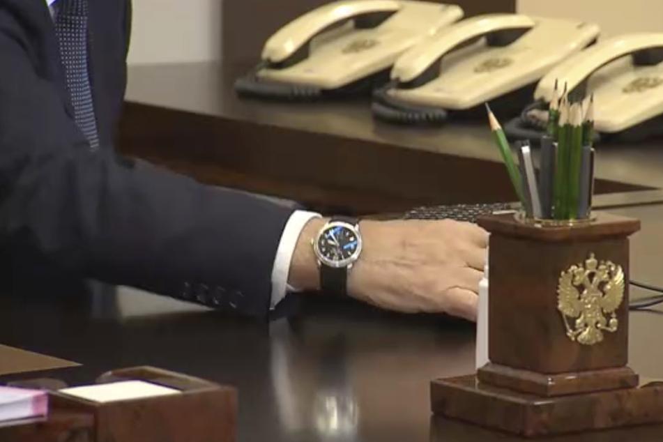 Welches Datum zeigt Putins Uhr?