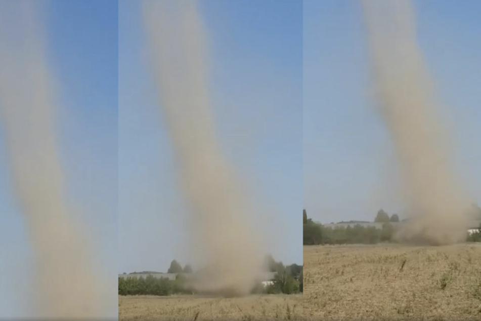 Im Video sieht man, wie eine Windhose über das staubtrockene Feld fegt.