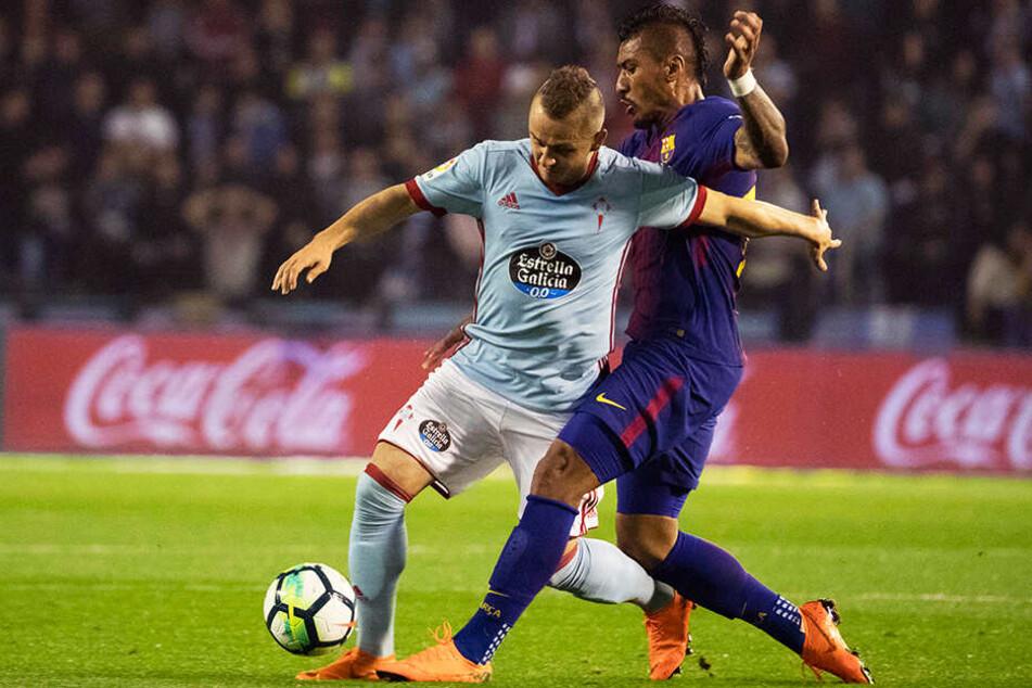 Celta Vigos Stanislav Lobotka (l.) soll beim BVB auf der Liste stehen. Der slowakische Nationalspieler, hier im Duell mit Barcas Paulinho, entwickelte sich bei all seinen Stationen auf Anhieb zum Stammspieler.