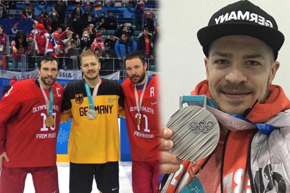 Moritz Müller zeigt seine Silbermedaille (r.)