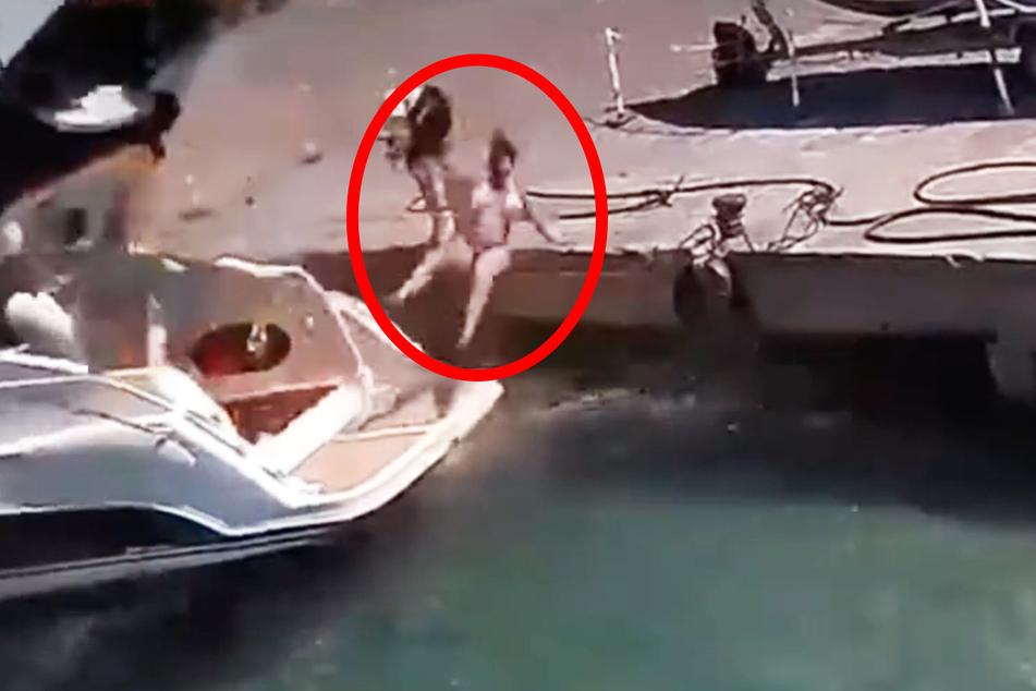 Die Frau flog in die Höhe und landete im Wasser.