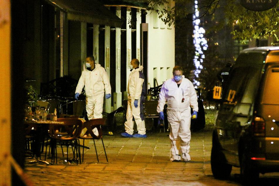 Investigators secure the crime scene after multiple people were shot in a terrorist attack.