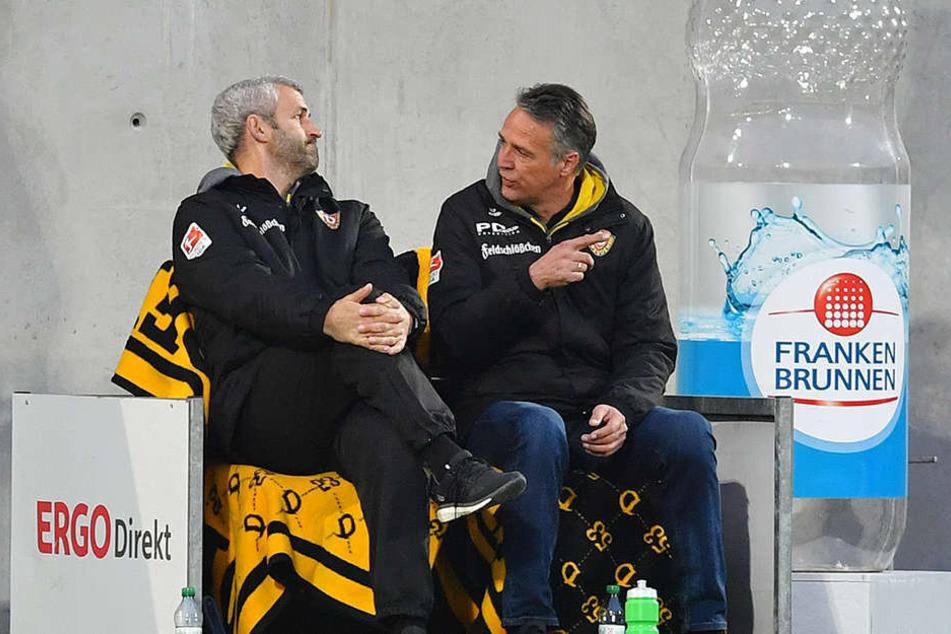 Flasche halbleer? Motivationsprobleme lassen Dynamo-Trainer Uwe Neuhaus (r.) und sein Assistent Peter Németh als Grund für die schwächeren Leistungen nicht gelten.