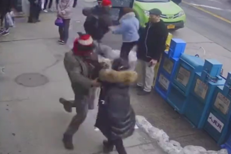 Security footage shows the suspect attacking the Asian-American woman in Flushing, Queens.