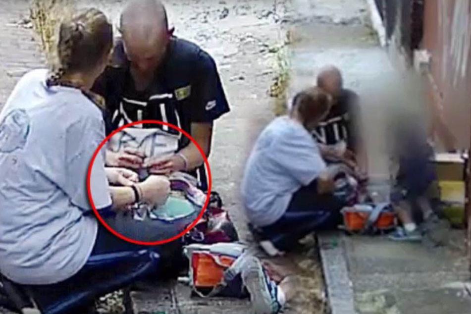 Hier spritzt sich eine Mutter vor ihrem vierjährigen Sohn Heroin