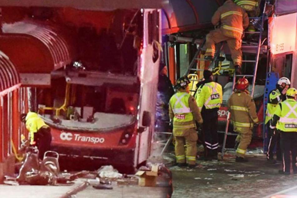 Der Doppelstockbus rammte das Wartehaus in Ottawa. Helfer versuchen dann, die Opfer und Verletzten zu bergen.