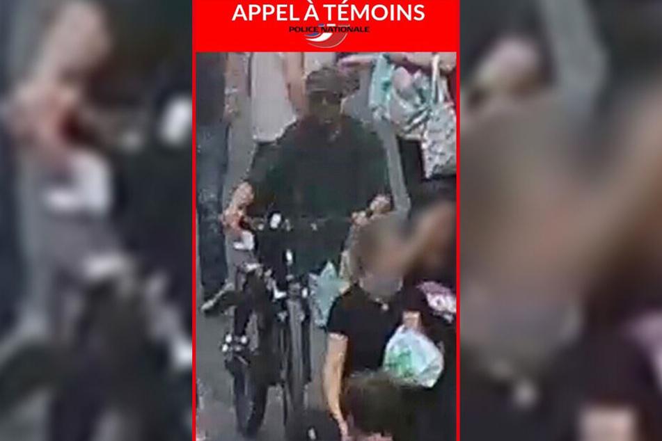 Der Screenshot von einer Webseite der französischen Polizei zeigt das Foto eines Verdächtigen, nach dem die Polizei im Zusammenhang mit einer Explosion in Lyon fahndet.