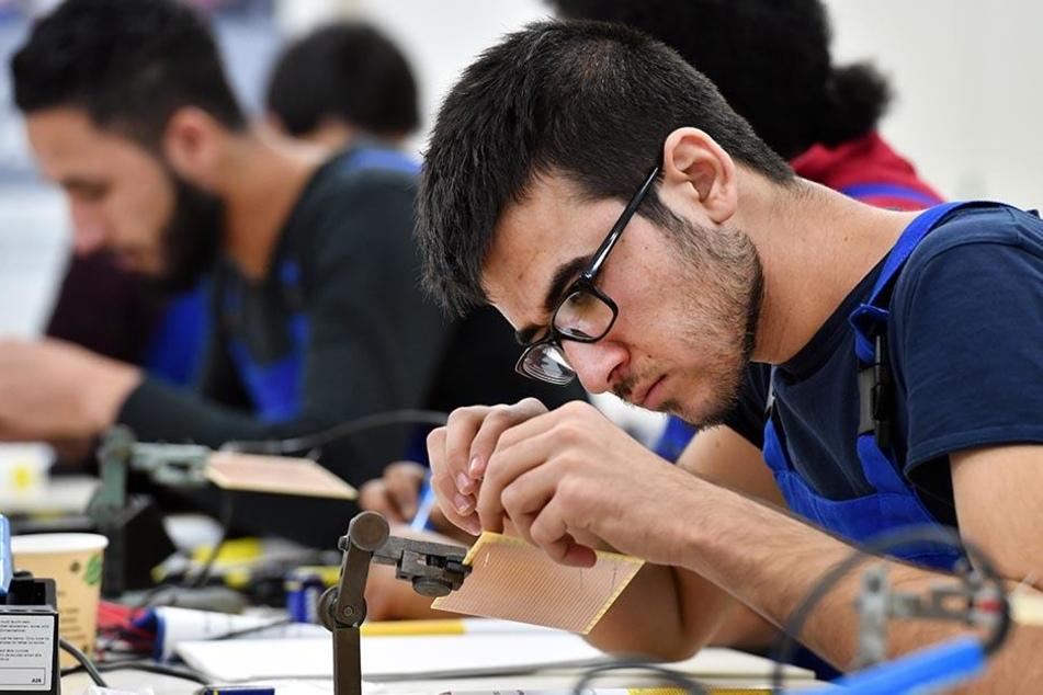 Einige Migranten fangen erst in Deutschland eine Berufsausbildung an.