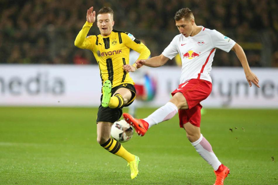 Orban im Zweikampf mit Reus. Die Dortmunder ließen zahlreiche Großchancen aus.