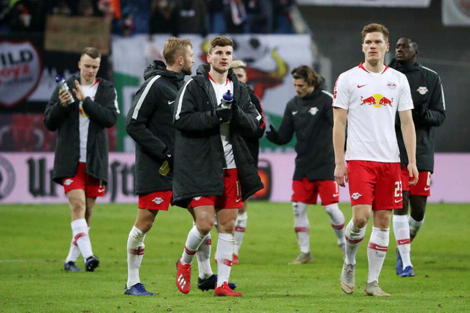 Timo Werner (vorn links) und Marcel Halstenberg (r.) waren sichtlich enttäuscht. Am Willen hat es gegen den BVB aber nicht gelegen.