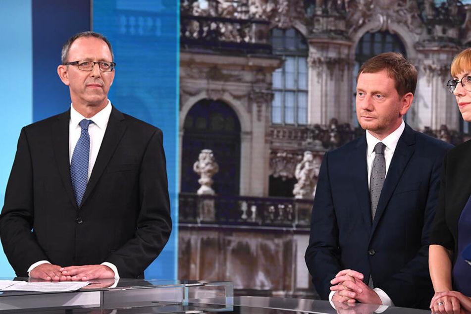 AfD-Spitzenkandidat Jörg Urban (55, links). Rechts im Bild MP Michael Kretschmer und Grünen-Politikerin Katja Meier.