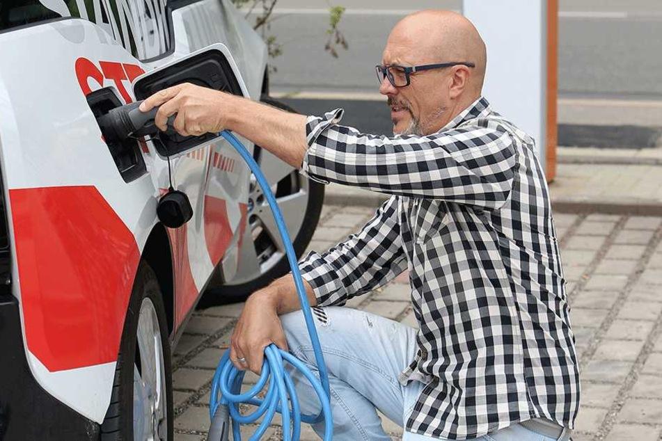 """Torsten Schmidt (49), Chef der Firma """"Let us Work"""" fährt seit über einem Jahr einen BMW i3."""