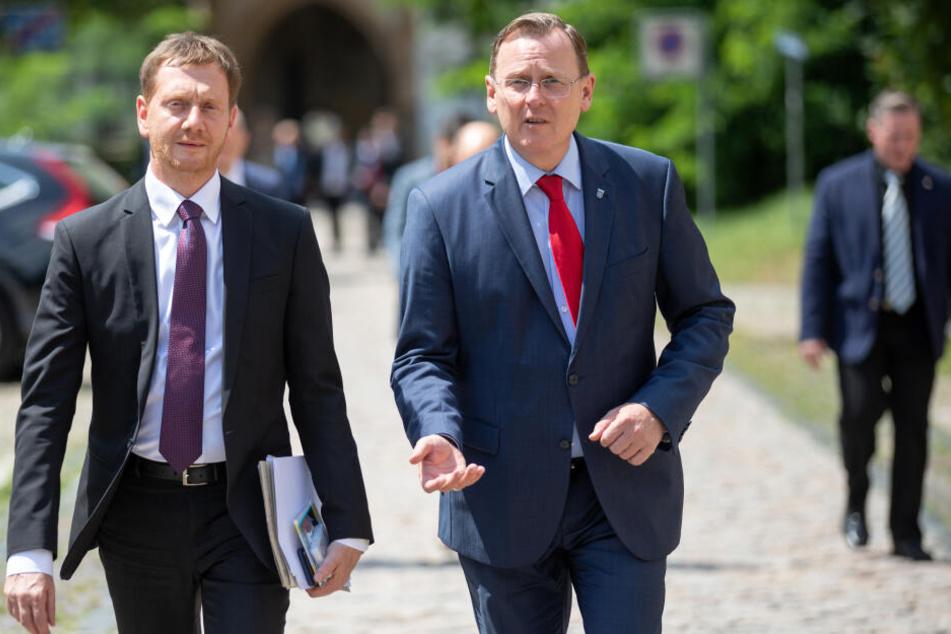 Michael Kretschmer (l.) sieht die Verantwortung zur Regierungsbildung in Thüringen bei Bodo Ramelow und der Linken.