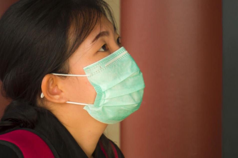 In ihrer Not behauptete die Frau, sich in Wuhan mit dem Coronavirus angesteckt zu haben. (Symbolbild)