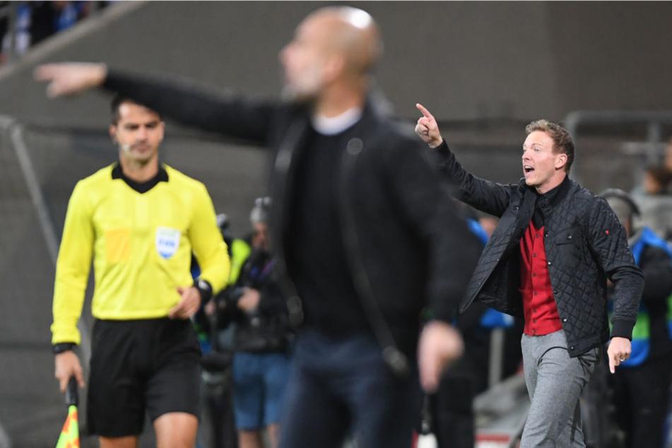 Ein Duell zwischen zwei Taktik-Füchsen: Manchester-City-Coach Pep Guardiola (l.) gegen TSG-Trainer Julian Nagelsmann. (Symbolbild)