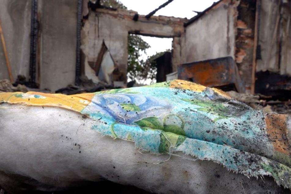 Die Leiche wurde in einer brennenden Gartenlaube gefunden.