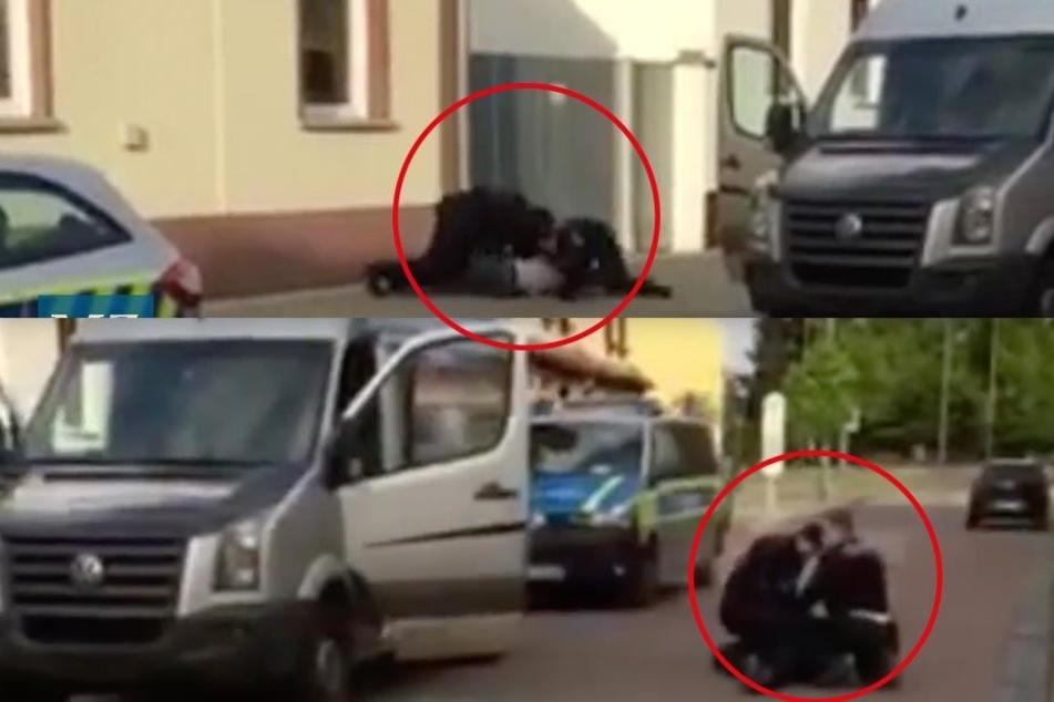 Polizeibeamte halten die zwei Transporter-Insassen am Boden fest. Wurde dabei einer der Männer mit dem Kopf in Glasscherben gedrückt?