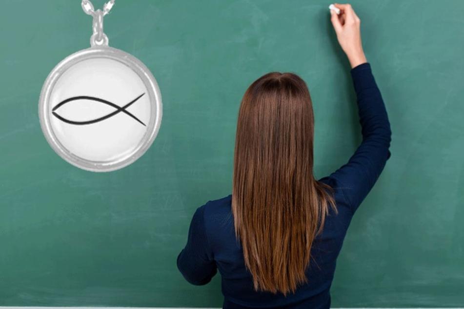 Die Lehrerin soll jetzt den eucharistischen Fisch um den Hals tragen (Symbolbild).