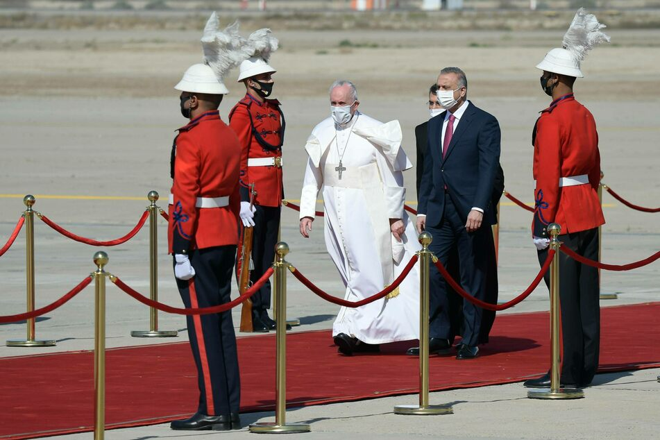 Pope Francis lands in Iraq amid Covid-19 spread and security tensions