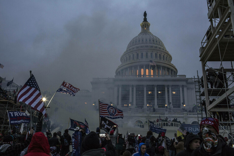 Security forces respond with tear gas after pro-Trump mob breached the US Capitol on January 6.