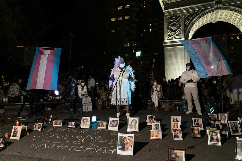 Washington Square, 2020: people held a vigil on transgender day of remembrance to commemorate the lives of transgender victims of violence, as their pictures sat on display.