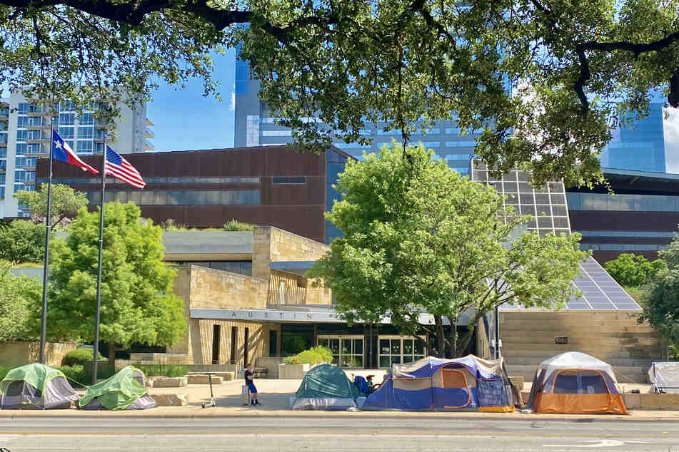 Several tents remained in front of Austin City Council on Monday as government officials and law enforcement began the citation process of Phase Two.