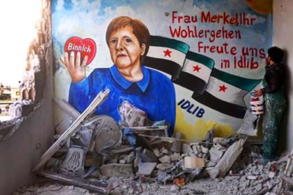 Riesiges Merkel-Graffiti in Syrien: Künstler freuen sich über Corona-Testergebnis