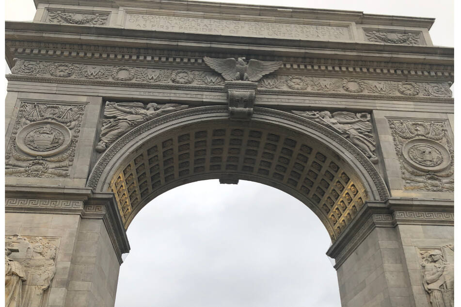 The famous Washington Square Arch was the scene of protests against a new park curfew on Saturday night.