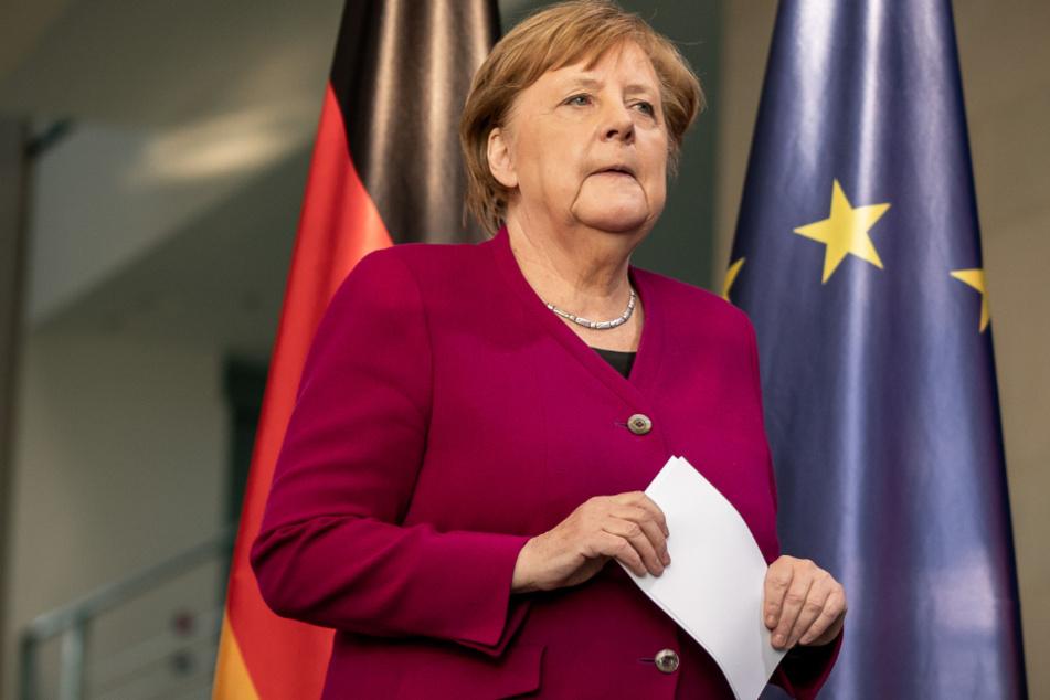 Kanzlerin Merkel (65, CDU).