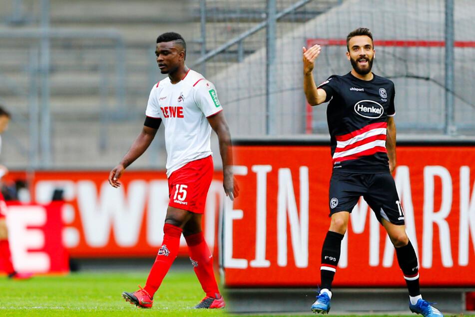 Kenan Karaman (r.) feiert seinen Treffer zum 1:0, während Kölns Jhon Cordoba betreten dreinschaut.