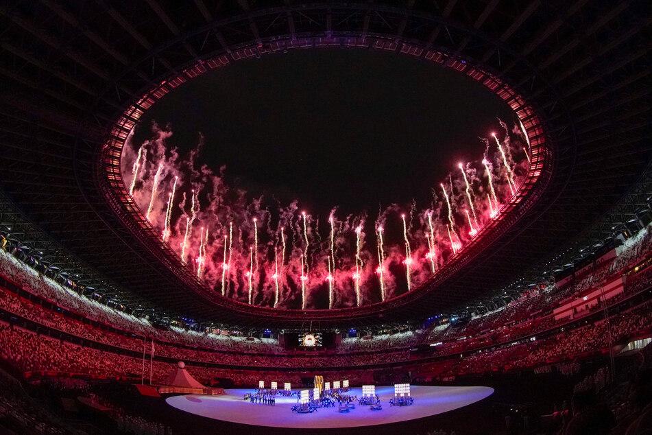 Tokyo Olympics: Naomi Osaka lights cauldron in quiet opening ceremony