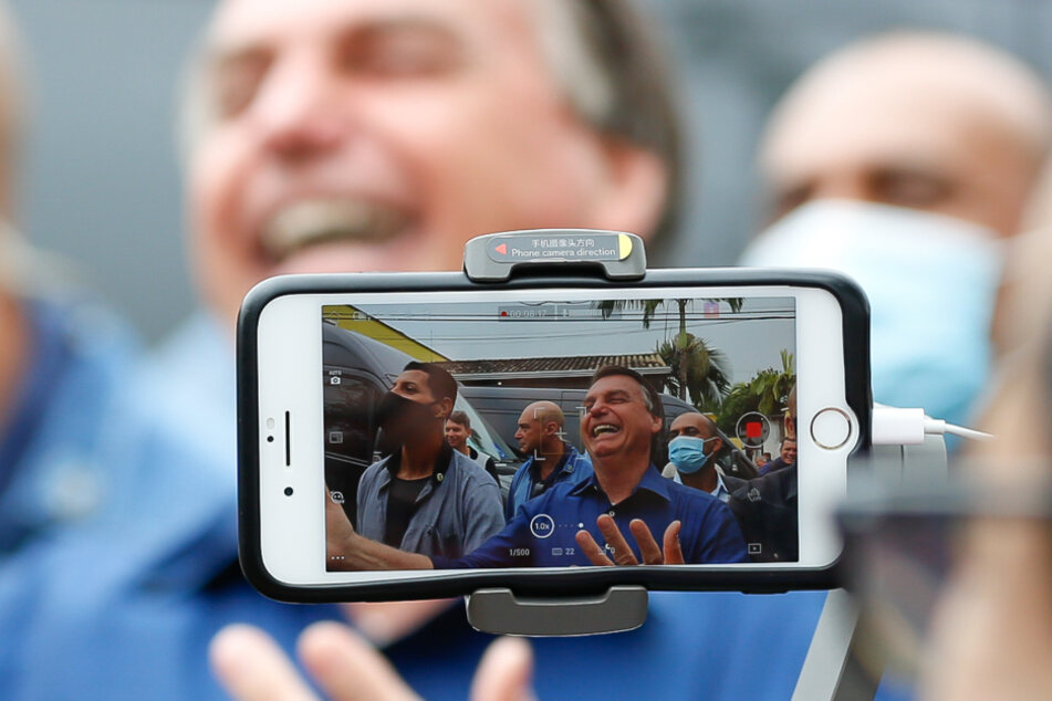 The image provided by the Brazilian president's office shows Jair Bolsonaro at a meeting with supporters in El Dorado.