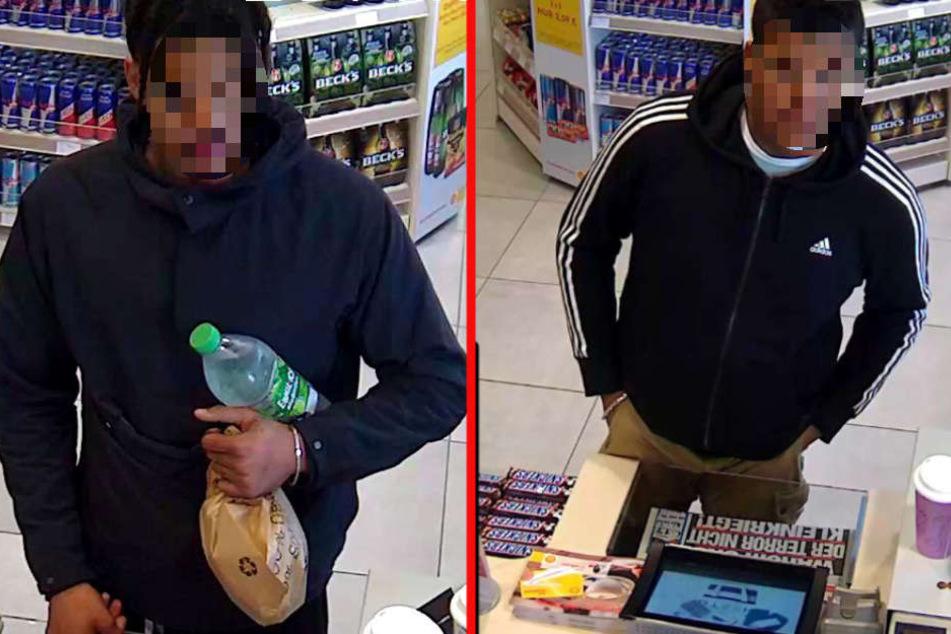 Diese zwei Männer werden verdächtigt, mit einer gestohlenen Kreditkarte bezahlt zu haben.