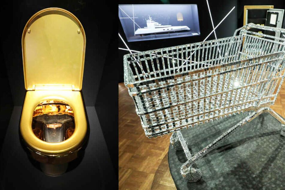 """Für manche muss es glamourös sein: Eine goldene Toilette und ein funkelnder Einkaufswagen in der Ausstellung """"purer Luxus""""."""