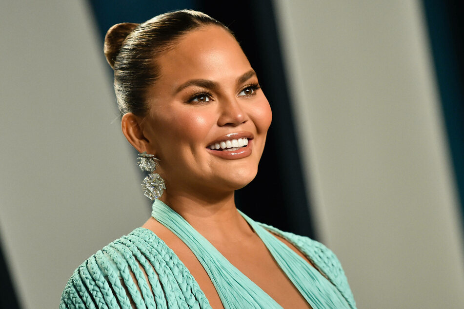 Chrissy Teigen feels honored to be among the 12 accounts Joe Biden follows on Twitter.