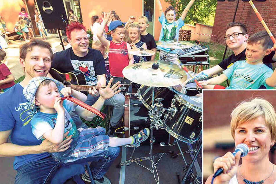 Die Arbeitslosen Bauarbeiter Thomas (33, vorn l.), Friedhelm (37) und Hanscher (31, r.) ließen auch die Kita-Kids mal an die Instrumente.     Kita-Leiterin Jutka Vaida-Fehlberg (re.) führte durch das Programm.