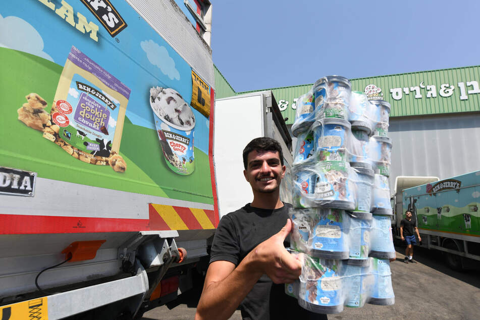 A worker handles tubs of Ben & Jerry's ice cream at a factory in Beer Tuvia in southern Israel.