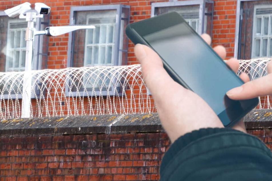 Immer wieder werden Handys illegal in Gefängnisse gebracht. (Symbolbild)