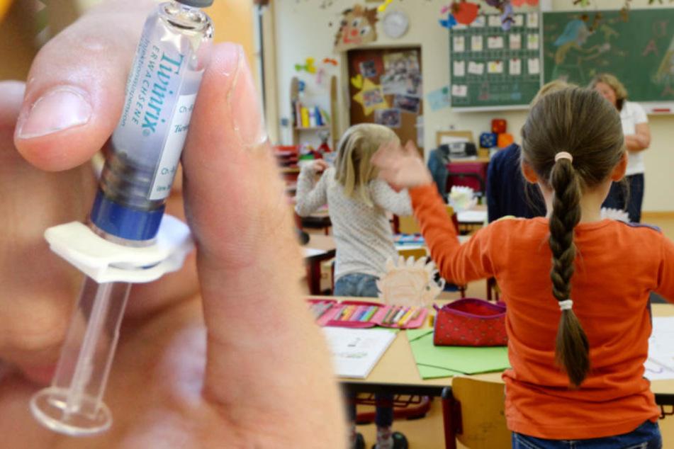 Kinder beim Schulunterricht (Symbolbild). Sie sollen dringend geimpft werden.