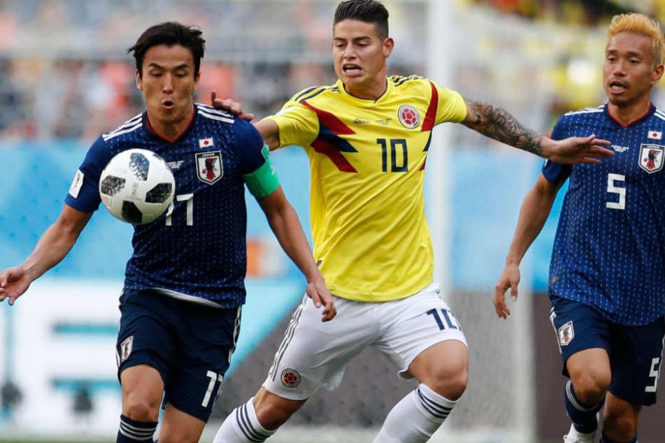 James Rodriguez (M.) konnte im Achtelfinale der WM nicht mehr eingreifen.