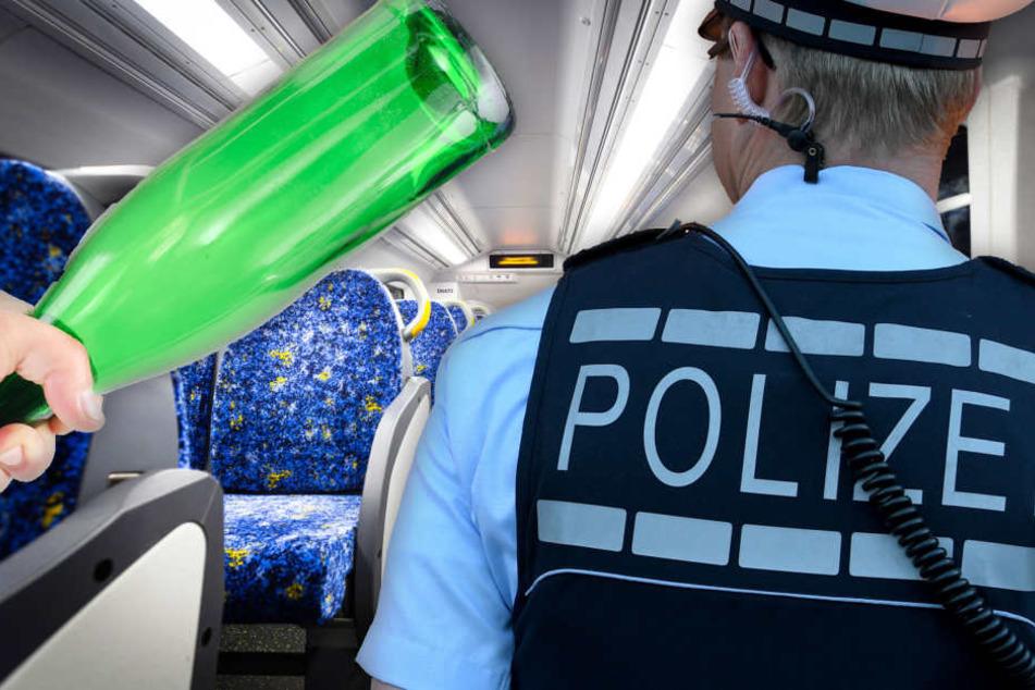 Trunkenbolde randalieren im Zug und gehen auf Polizei los - dann fliegt eine Flasche