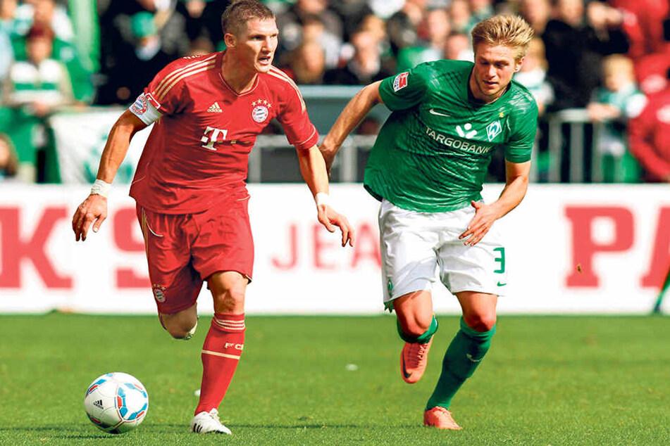 Der heutige Chemnitzer Florian Trinks (r.) in der Bundesliga-Saison 2011/12 als Bremer im Zweikampf mit Bastian Schweinsteiger.