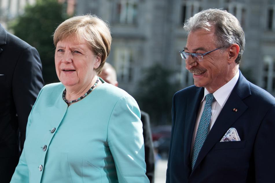 Bundeskanzlerin Angela Merkel (CDU) wird von Dieter Kempf, Präsident des Bundesverbands der Deutschen Industrie (BDI).