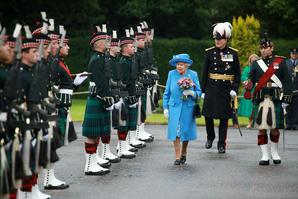 The Queen and Prince William tour Scotland and try a very special drink