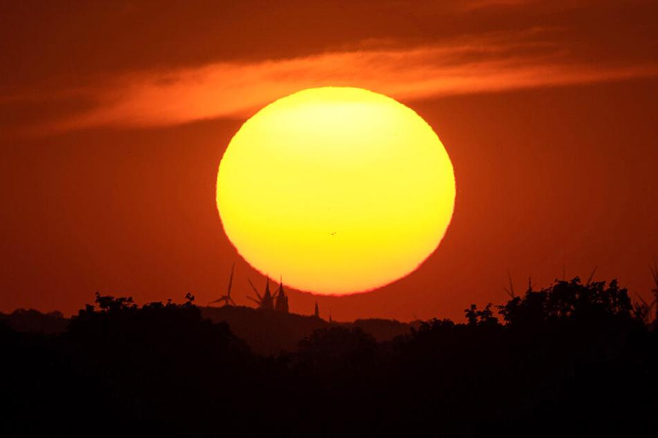 Ein malerischer Sonnenaufgang könnte durch Regenschauer getrübt werden.
