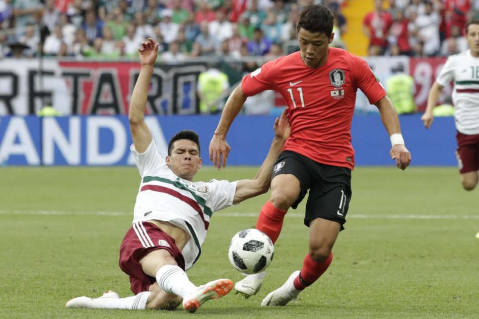 Hee-Chan Hwang (r) während der WM 2018 im Spiel gegen Mexiko. (Archivbild).