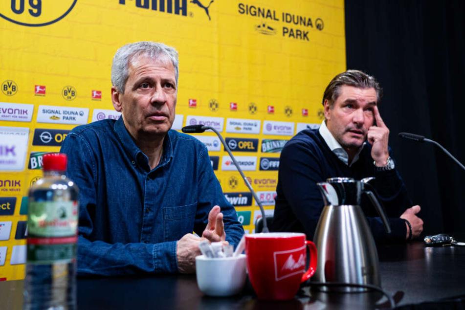 BVB-Sportdirektor Michael Zorc (r.) äußerte sich diplomatisch zur Lage von Coach Lucien Favre.