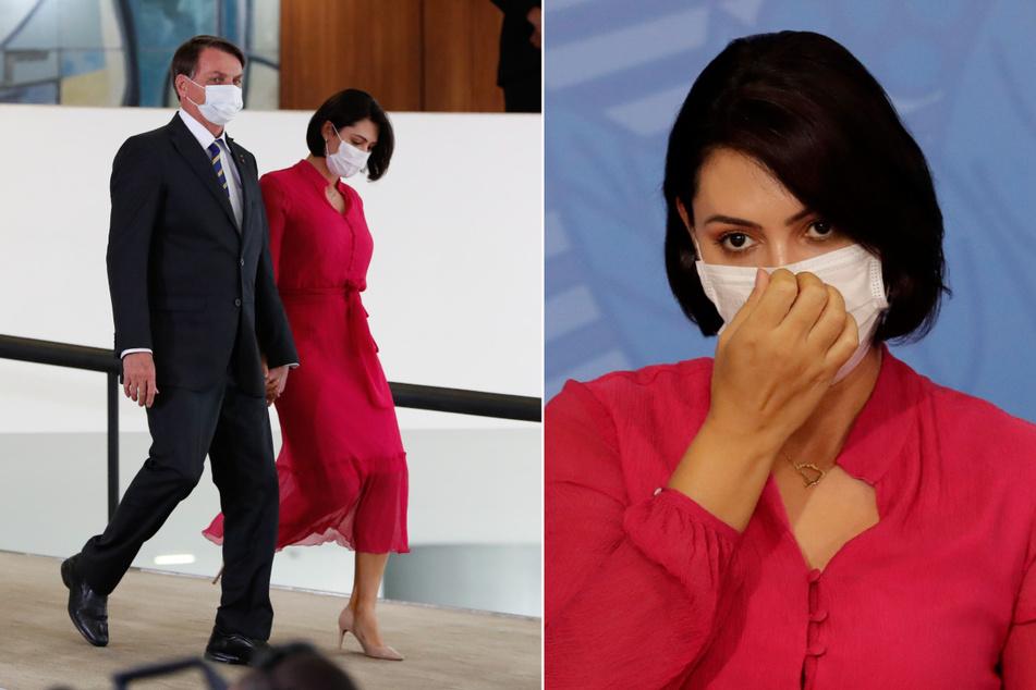 Auf diesem vom brasilianischen Präsidentenamt zur Verfügung gestellten Bild kommen Jair Bolsonaro, Präsident von Brasilien, und seine Frau Michelle mit Mundschutz zu einer Veranstaltung im Regierungspalast.